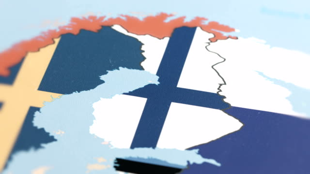 finland with national flag on world map - helsinki video stock e b–roll