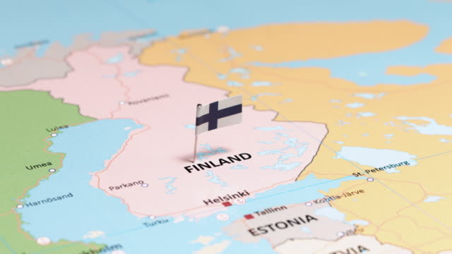 finland with national flag - finlandia video stock e b–roll