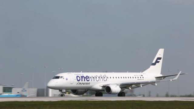 a finnair oyj aircraft part of the oneworld alliance taxis on runway after landing at manchester airport in manchester a thomson aircraft part of the... - plc stock videos & royalty-free footage