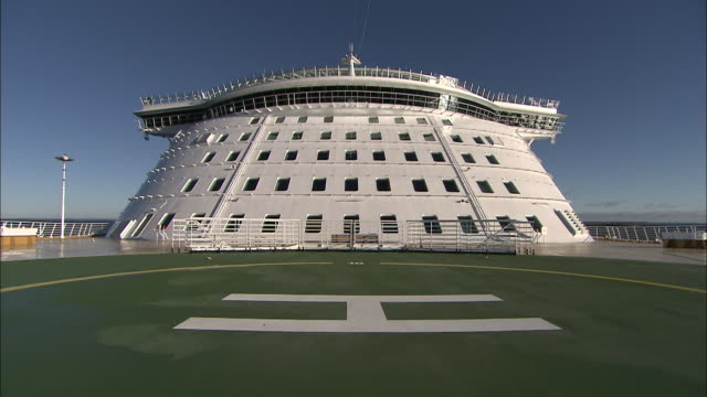 A Finnish cruise line features a putting green on a recreation deck.