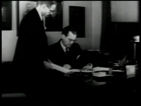finnish embassy finland ambassador hjalmar procope working in office looking at gas masks rifles reception taking telegram from messenger letters... - telegram stock videos and b-roll footage