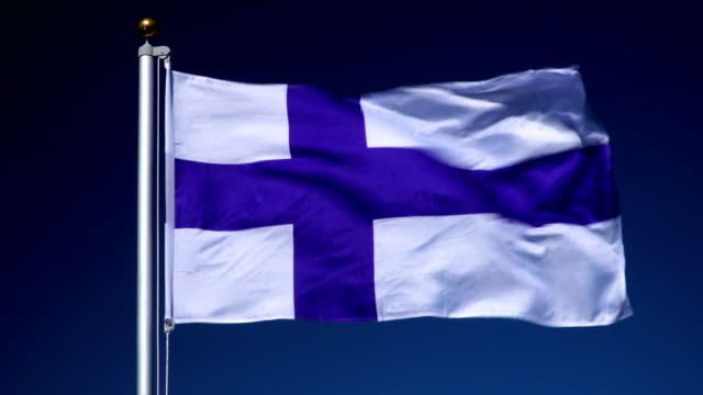 4K: Finnish Flag on Flagpole in front of Blue Sky outdoors (Finland)