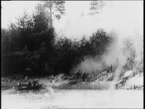 finnish troops walk along road, pass trucks / finnish field gun firing / explosions across river / soldier with machine gun / soldiers crawling... - rowing boat stock videos & royalty-free footage