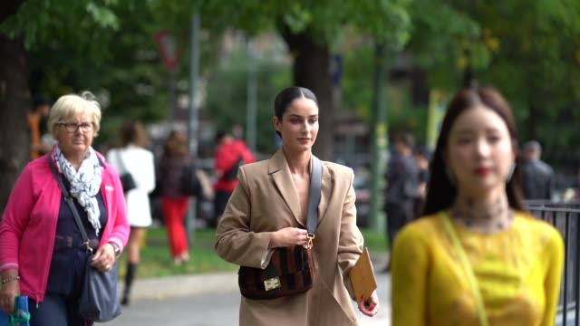 fiona zanetti wears a light brown blazer jacket pants a brown striped fluffy fendi bag outside the fendi show during milan fashion week spring/summer... - spring summer collection stock videos & royalty-free footage