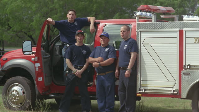 WS Fire and rescue team posing next to fire truck / Elmendorf, Texas, USA