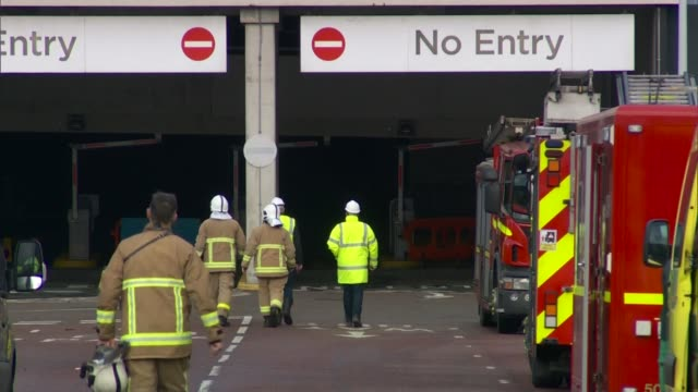 Hundreds of vehicles destroyed ENGLAND Liverpool King's Dock EXT Firefighters and fire engines at scene of car park fire Firedamaged multistorey car...