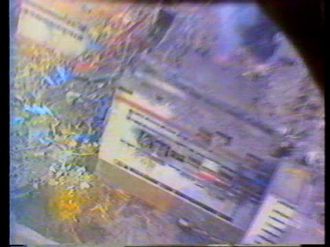 fire at chernobyl; ext/april 1986: airv reactor building damaged after explosion lbv man running along track forwards airv men running on power... - russia video stock e b–roll