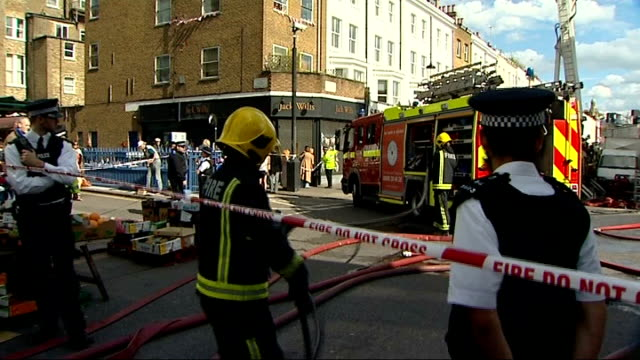 vídeos de stock e filmes b-roll de cleanup operation underway england london notting hill ext firefighters outside electric cinema fire engine and firefighters firefighter on platform... - portobello
