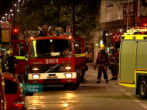 london oxford street fire engines and officers parked outside cordonedoff 'metal militia' shop near tottenham court road tube station - itv london lunchtime news stock-videos und b-roll-filmmaterial