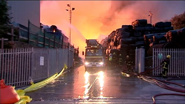 fire at recycling plant in stockport england greater manchester stockport bredbury various of firefighters tackling blaze at recycling plant day... - brigade stock videos and b-roll footage