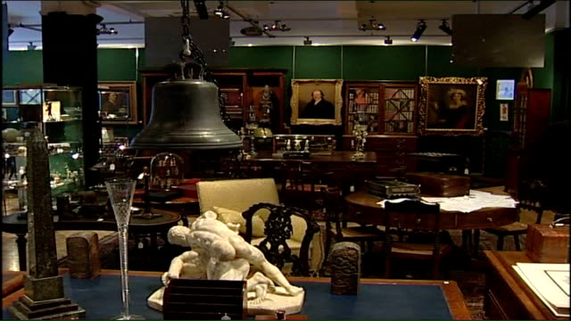fire bell at biggin hill auctioned for charity; england: london: bonhams int fire bell general view of auction house man flicking through bonhams... - biggin hill stock videos & royalty-free footage