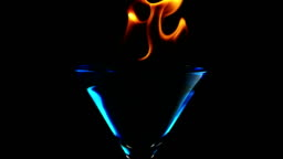 Fire blowing out of martini glass, Slow Motion
