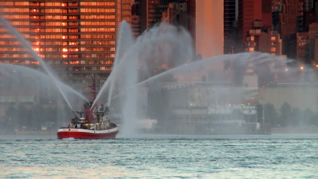 WS Fire boat spraying its water spouts on Hudson River / New York City, USA