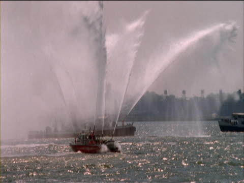 Fire Boat Spraying Large Jets of Water on the Hudson River, New York, USA