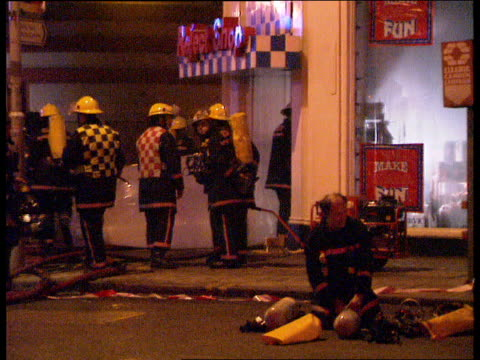 fire bombs england london tottenham ct road ms fire services vehicles outside reject shop cla 'reject shop' above entrance to shop bv firemen by... - discount shop stock videos & royalty-free footage