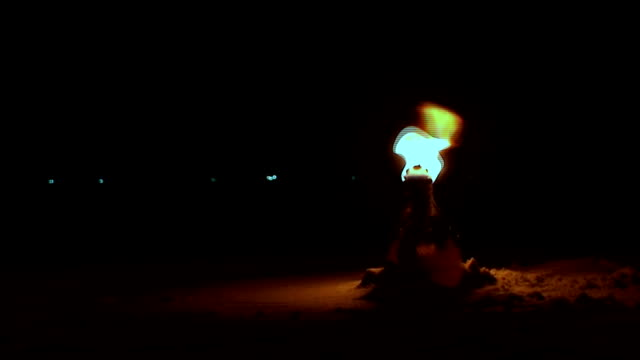 fire bottle lantern in the sand - close up - molotov cocktail stock videos and b-roll footage