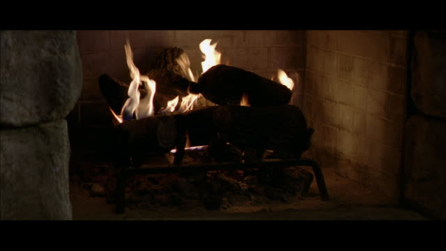 ha fire burning in a fireplace - stone material stock videos & royalty-free footage