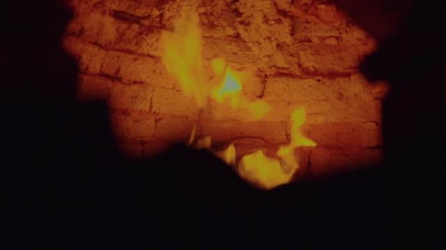 fire burning in brick kiln - furnace stock videos & royalty-free footage