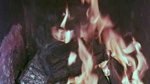 1967 MONTAGE Fire burning in fireplace / Handsworth, West Midlands, England