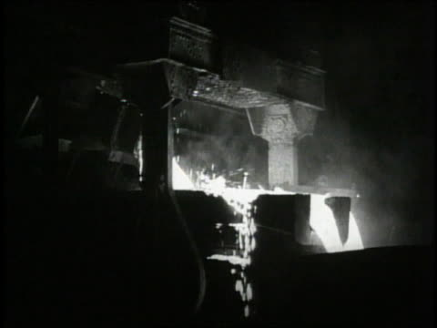1940 MS Fire burning in iron ore factory / United States