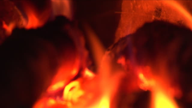 fire burning in the chimney (loopable, close-up, sound included, hd) - briquette stock videos & royalty-free footage