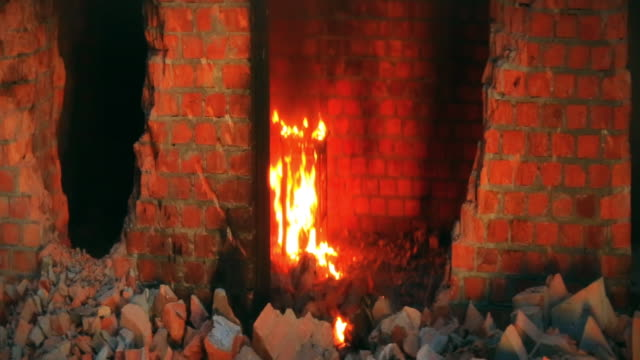 fire burning inside brick building. sparks. shoot with anamorphic lenses - explosion wall stock videos and b-roll footage