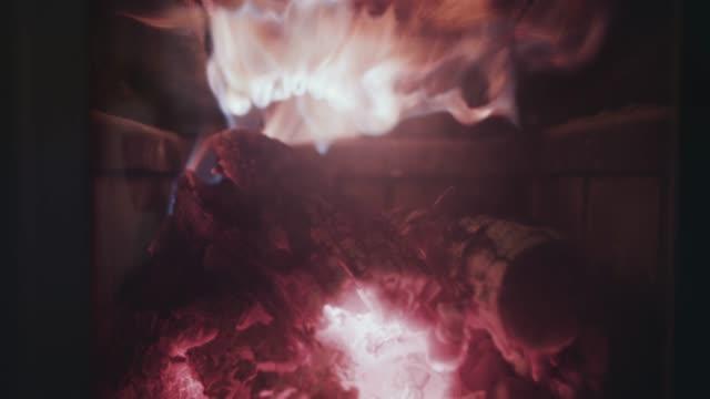 fire burning inside fireplace - idyllic stock videos & royalty-free footage