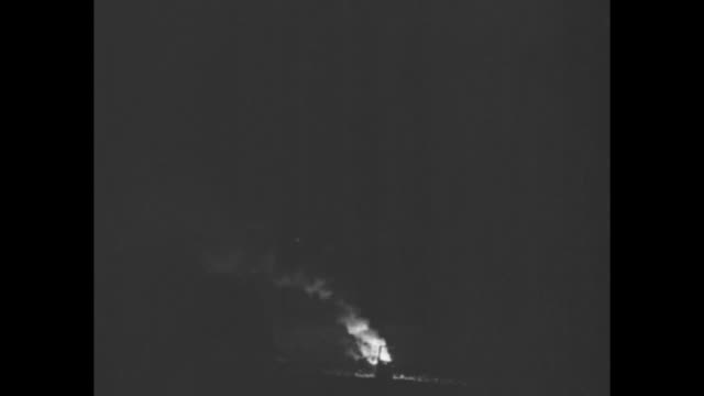 "fire burning on bank of river in front of prow of grounded steamship ""robin goodfellow"" / closer shot of two fires burning at night on bank on either... - robin day stock videos & royalty-free footage"