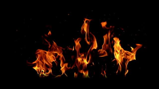 vídeos de stock e filmes b-roll de fire burning (the background can be removed with a blending mode like add) - filme de ação