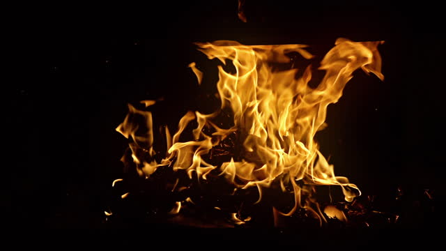 fire burning (the background can be removed with a blending mode like add) - plain background stock videos & royalty-free footage