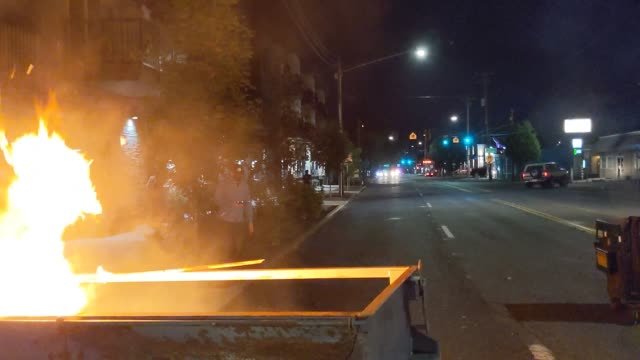 fire burns in a dumpster fire early in the morning after protests in the city on august 29, 2020 in portland, oregon. friday, august 28 marked the... - portland oregon stock videos & royalty-free footage