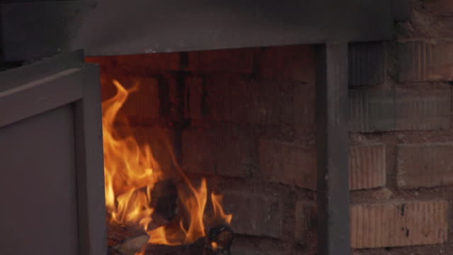 fire burns to heat the kiln - hearth oven stock videos & royalty-free footage