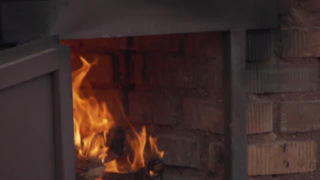 fire burns to heat the kiln - kiln stock videos and b-roll footage