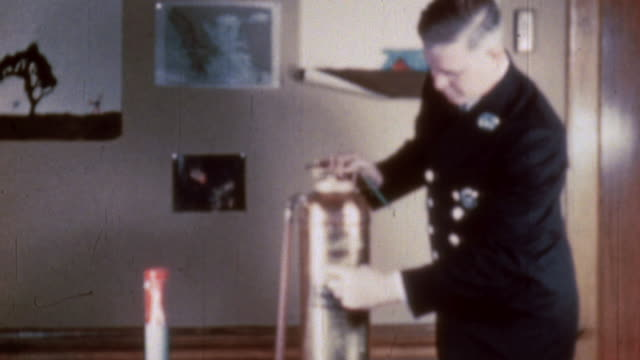 fire chief demonstrating how to use a fire extinguisher and discussing how to manage an incendiary bomb / worcester massachusetts united states - fire extinguisher stock videos & royalty-free footage