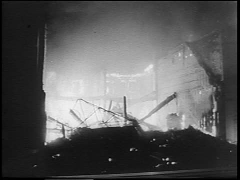 b/w 1967 fire coming from destroyed building after race riots at night / detroit michigan / news - 1967 stock videos & royalty-free footage