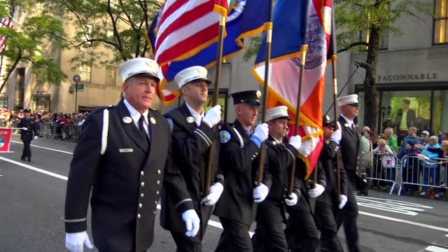 fire commissioner daniel a nigro and members of the fdny march during the columbus day parade on 5th avenue midtown manhattan new york city usa - fire department of the city of new york stock-videos und b-roll-filmmaterial