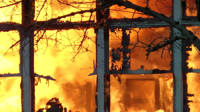 fire consumes a building - burnt stock videos & royalty-free footage
