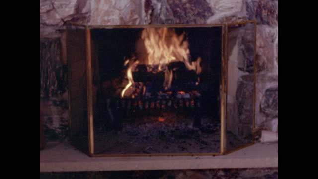 fire crackling in fireplace behind grate - heat stock videos & royalty-free footage