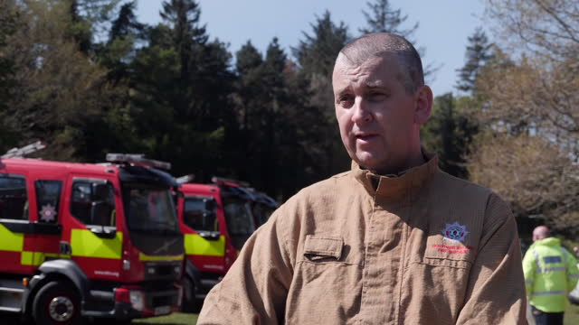 fire crews battle wildfires in northern ireland. shows: fire crews tackling forest fires, burnt out gorseland after fires, drone aerials of mountain... - report produced segment stock videos & royalty-free footage