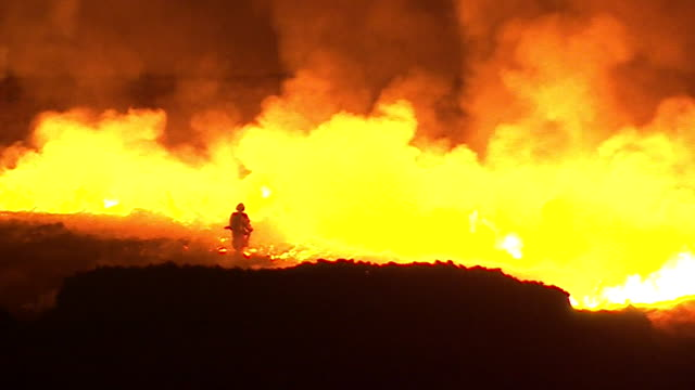 fire crews treat huge moorland fire near saddleworth moor, west yorkshire - silhouette stock videos & royalty-free footage