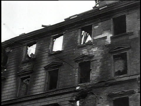 vídeos de stock e filmes b-roll de ts fire damage on a building after the german invasion of warsaw / warsaw poland - 1939