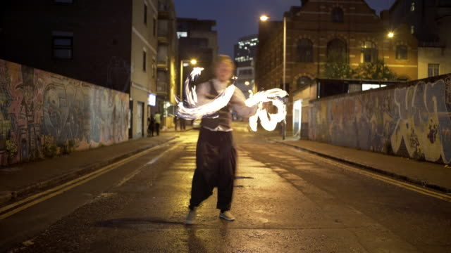 fire dancer in the street - performing arts event stock videos and b-roll footage