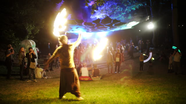Fire dancer in the woods