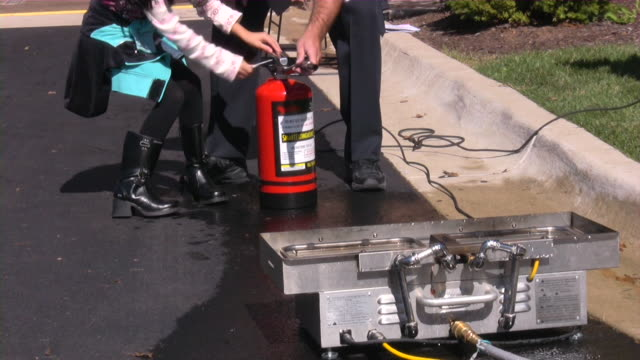 Fire Department Open House: Firefighters presenting rescue and safety equipment.