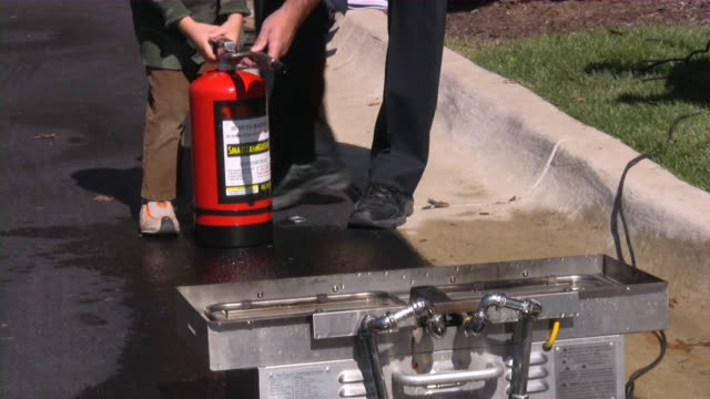 fire department open house: firefighters presenting rescue and safety equipment. - fire extinguisher stock videos & royalty-free footage