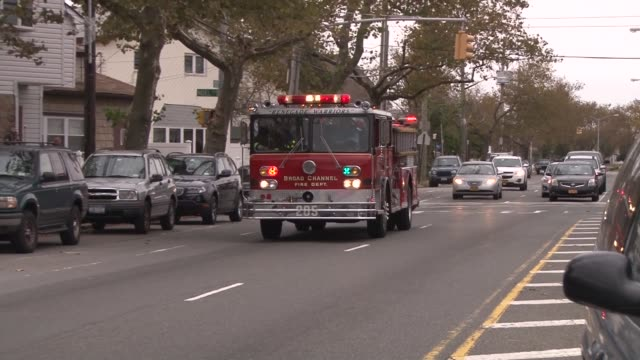 fire dept patrolling residential area ordering evacuation prior to hurricane sandy - instructions stock videos & royalty-free footage