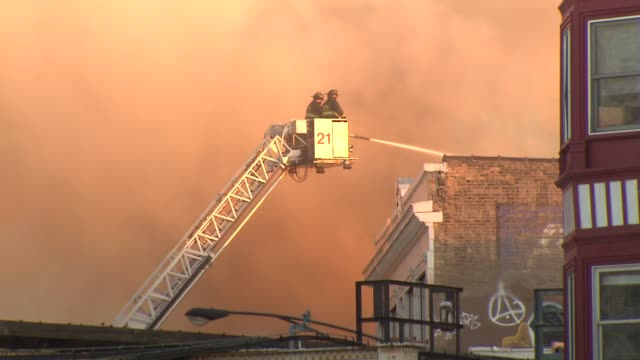 a fire destroyed 3 wrigleyville businesses the samah hookah lounge the roadhouse 66 and thai classic there were no injuries firemen housing fire from... - cherry picker stock videos & royalty-free footage