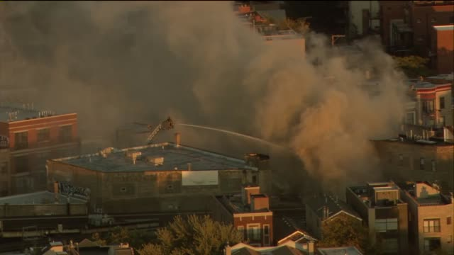 a fire destroyed 3 wrigleyville businesses the samah hookah lounge the roadhouse 66 and thai classic there were no injuries aerial of firemen hosing... - cherry picker stock videos & royalty-free footage