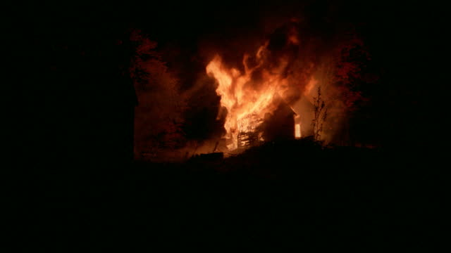 a fire destroys a country house at night. - inferno stock videos & royalty-free footage