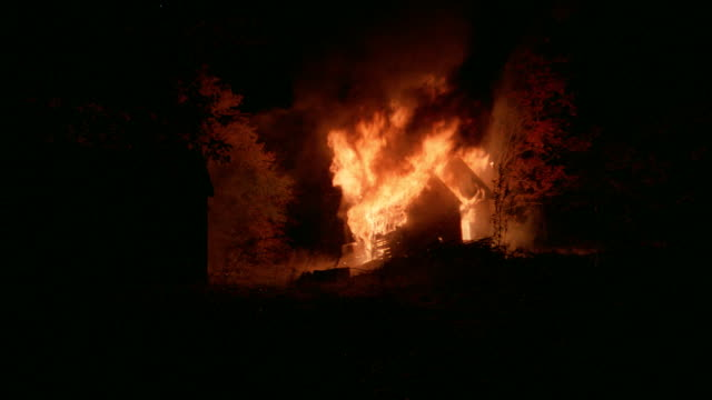 a fire destroys a house in the night. - inferno stock videos & royalty-free footage